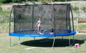 The girls jumping on their new trampoline.